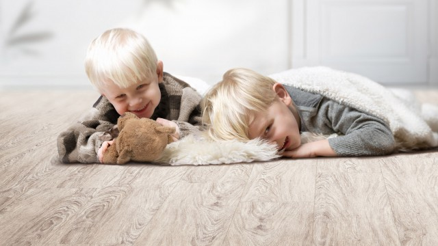 Boys playing on floor by Christmas tree